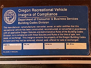 All of our tiny houses on wheels are licensed by the State of Oregon as an RV, which is recognized both nationally and internationally. The Oregon Recreational Vehicle Insignia of Compliance is always placed near the door to show the vehicle is safe and follows ANSI code. With the Oregon RV Insignia of Compliance and the width of the tiny house not exceeding 8.5 feet, the Department of Motor Vehicles assigns a licensed plate and an RV title for quick and easy transport. Just hook up, check tires and lights, and go!
