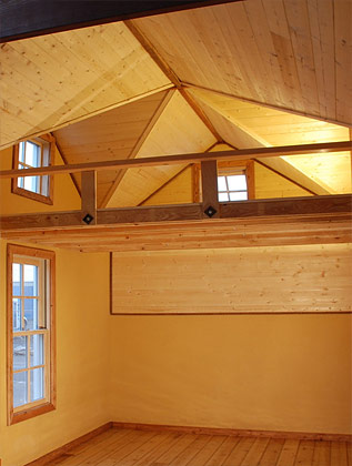 Our double gable roof design found in several of our tiny house models is a unique feature to many of our Tiny SMART House tiny homes. The double gable effectively doubles the headroom in the loft.